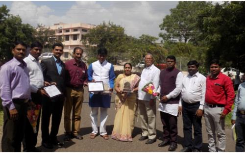 Principal Dr.Deshmane P.B.,Hon.Pandurang Kshirsagar  and Hon.Dr.Raju Machale with staff members