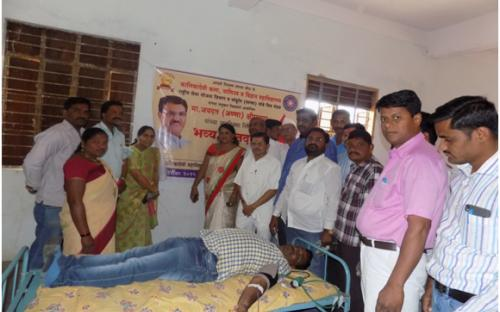 A volunteer donating blood on the occasion of   Birthday of Hon. Jaydattaji (Anna)